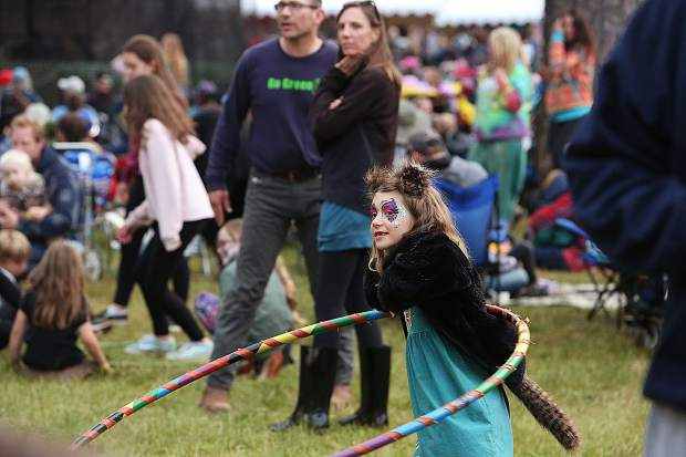 A young hula hooper tries her thing on the lawn in front of the main stage during Saturday's lineup of the Strawberry Music Festival.