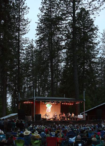 The Strawberry Music Festival stage stands illuminated amongst the pines of the Nevada County Fairgrounds Saturday, silhouetted by the light of the setting sun.