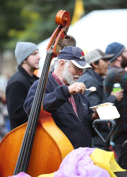 Jerry Paul grabs a bite of chili in between a day full of playing his upright bass in various jamming circles at Strawberry Music Festival in Grass Valley Saturday.