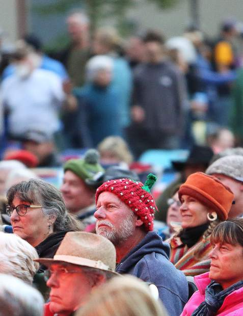 Strawberry hats and pins are standard attire for Strawberry Music Festival attendees.