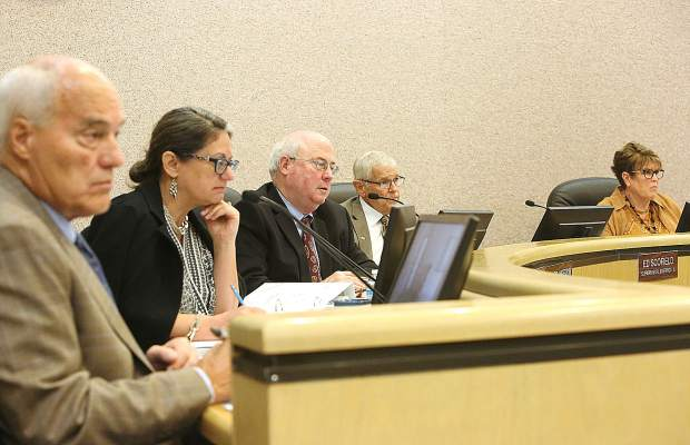 Nevada County Board of Supervisors Dan Miller (from left) Heidi Hall, Richard Anderson, Ed Scofield and Sue Hoek listen to the many comments from the public regarding the proposed cannabis ordinance during a Tuesday Board of Supervisors meeting.
