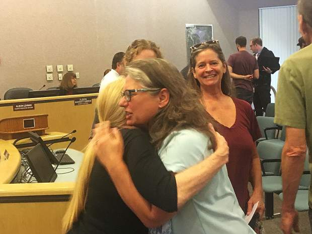 Supervisor Heidi Hall, right, hugs a woman after Tuesday's vote of the Nevada County Board of Supervisors. The 4-to-1 votes implemented new cannabis grow rules.