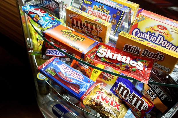 An illuminated candy display is part of the new lowered Americans with Disabilities Act-accessible counter in the lobby of Sutton Cinemas. The theater was closed for about a week while construction crews made the upgrades.