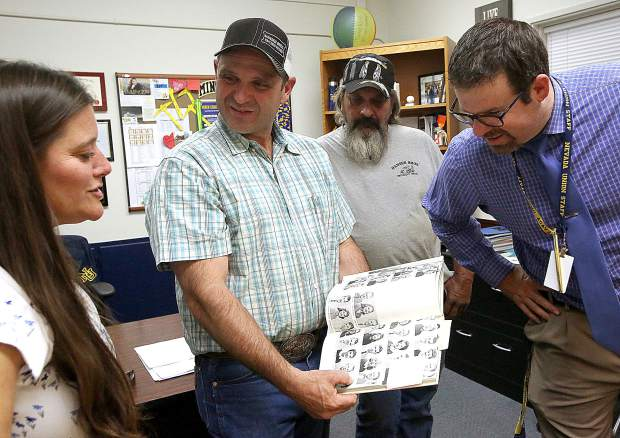 Jeff Hansen of Hansen Brothers Enterprises, shows off a picture of his father in one of the school's yearbooks that was unearthed by Hansen Bros. workers in front of Nevada Union High School.