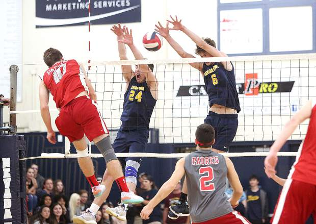 Judah Myers (24) and Carter Depue (6) attempt to stop a spike from Carmel Padres' Ben Airola (10) during Tuesday's Norcal playoff matchup.