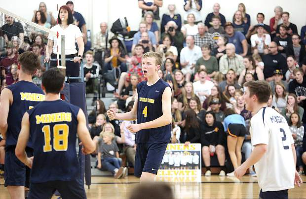 Nevada Union's Colby Quiggle and the rest of the varsity Miners' boys volleyball team celebrate after scoring winning the first set against the Carmel Padres Tuesday at home.