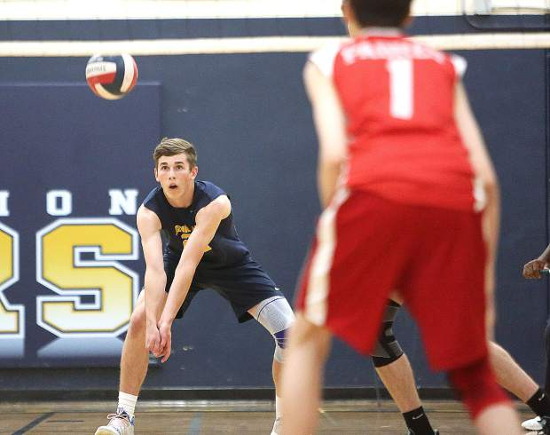 Nevada Union's Judah Myers (24) digs the ball from a Carmel serve during Tuesday's matchup.