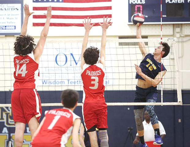Nevada Union High School's Preston Nowak (18) makes a forceful spike during the Miners' Norcal volleyball playoff matchup against the Carmel Padres.