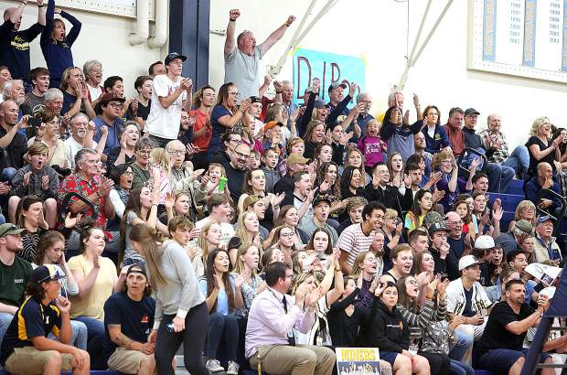 The varsity Miners volleyball home fans cheer on the section title champs as they take on the Carmel Padres in the Norcal playoffs Tuesday at Albert Ali Gymnasium.
