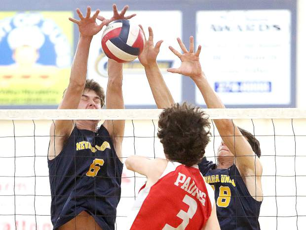 Nevada Union High School seniors Carter Depue (6) and Preston Nowak (18) team up for a block during the Miners' Norcal volleyball playoff matchup against the Carmel Padres.