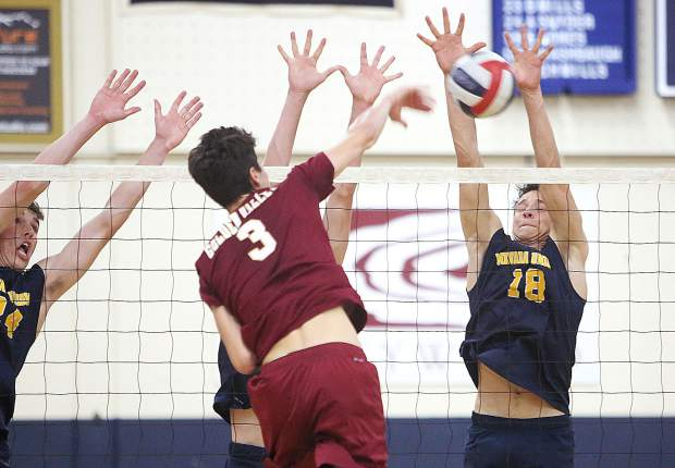 Nevada Union High School junior Preston Nowak makes a block for a point during the Miners' win in four sets over the Golden Valley Cougars.