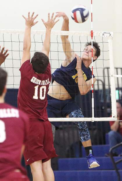 Nevada Union High School junior Preston Nowak makes a  spike for a point during the Miners' win in four sets over the Golden Valley Cougars.