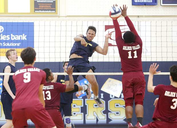 Nevada Union High School senior Cameron Dallago puts one over the net during the Miners varsity boys volleyball semifinal win over the Golden Valley Cougars of Merced.
