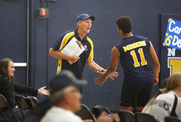 Miners varsity volleyball head coach Lance Mansuetti congratulates Cameron Dallago after scoring a series of points during Tuesday's win over the Golden Valley Cougars.