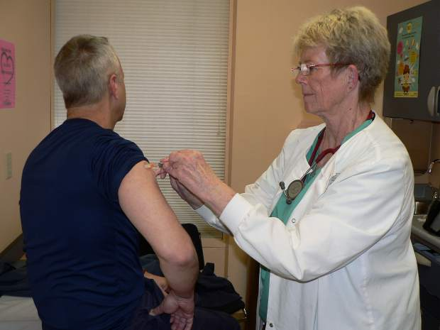 YubaDocs Certified Radiology Technician/Medical Assistant Sue Brewer administers a vaccine.