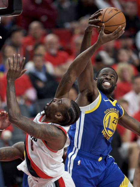 Golden State Warriors forward Draymond Green, right, posted a triple-double to help the Warriors beat the Portland Trail Blazers in Game 4 of the Western Conference finals Monday and complete the series sweep.