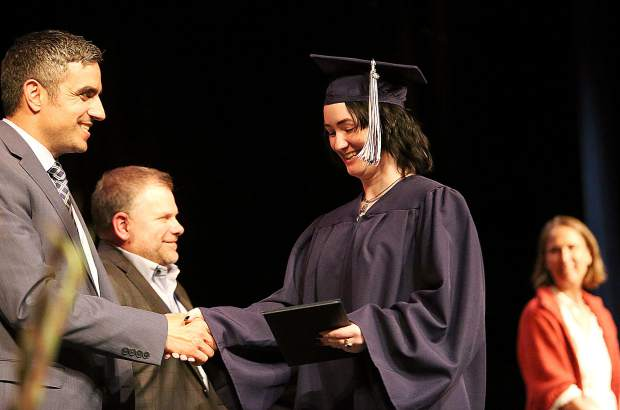 Felicity A. Brock accepts her diploma during Tuesday's Nevada Union Adult Education graduation ceremony for the class of 2019 at the Don Baggett Theatre.