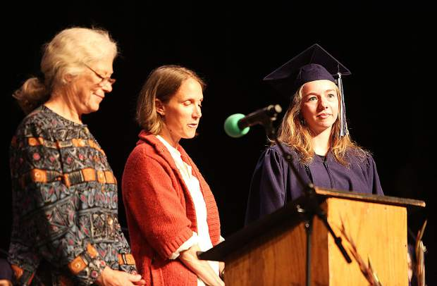 A graduate is recognized by Nevada Union Adult Education's Beth Huseby and Gillian Blair.