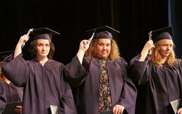 Nevada Union Adult Education graduates move their tassels from the left to the right side of their caps, signifying their commencement during Tuesday's ceremony at the Don Baggett Theatre.