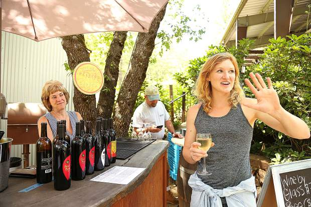 2019 Ag Tour attendee Maddison Easley marvels at the grounds of Pilot Peak Winery during the fifth and final stop of the Nevada County Farm Bureau's annual showcase of five western Nevada County farms. Easley is holding a glass of Pilot Peak's 2016 Chardonnay.