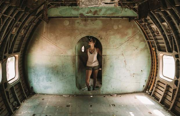 Lexie Alford is seen here in an old, broken down airplane in Eritrea. By 2018, she visited 120 countries. During that time, she said she began to understand traveling as a highly subjective experience.