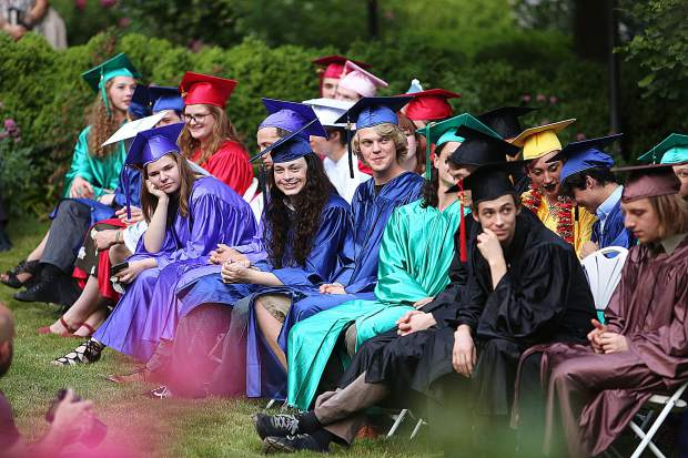 Attendees of Bitney Prep High School's Class of 2019 listen to the heartfelt speech given by Amy Pugel, who gave the Faculty Address during Friday evening's rose garden commencement ceremony.