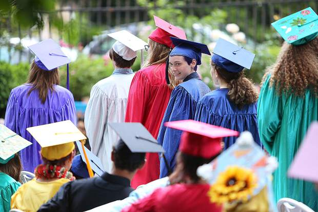 Fredi Gauge Lund-Johnson smiles back at her classmates during Friday's Bitney Prep Commencement Exercises held at the Mount Saint Mary's Academy Rose Garden.