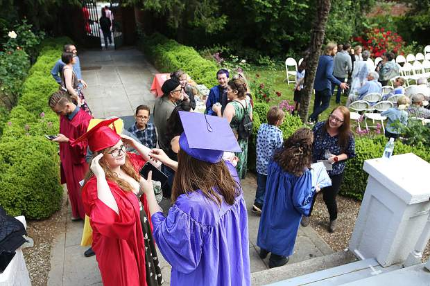 Bitney Prep class of 2019 students get ready for their commencement exercises Friday evening at the Mount Saint Mary's Academy Rose Garden.