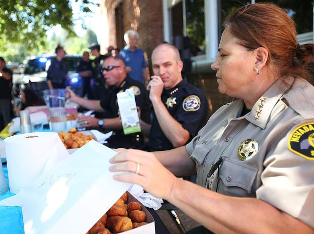 Nevada County Sheriff Shannan Moon (from right), Grass Valley Chief of Police Alex Gammelgard, and Nevada City Chief of Police Chad Ellis chow down on donut holes during Thursday's donut hole eating challenge at Grass Valley Charter School.