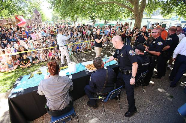 Nevada County, Grass Valley and Nevada City police officers take part in the donut hole eating challenge during class at Grass Valley Charter School.