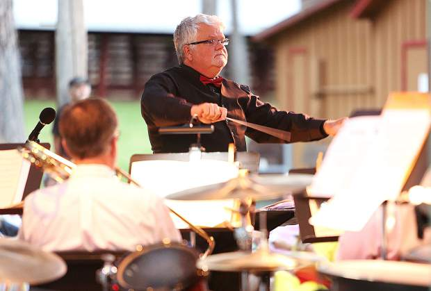 Outgoing Music in the Mountains artistic director Pete Nowlen conducts the live brass ensemble show Tuesday evening at the Pine Tree Stage of the Nevada County Fairgrounds for the inaugural Brass Brats and Brews event.