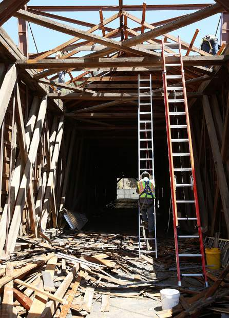 Extension ladders are used to access the rafters of the Bridgeport covered bridge during work Wednesday at the South Yuba River State Park at Bridgeport.