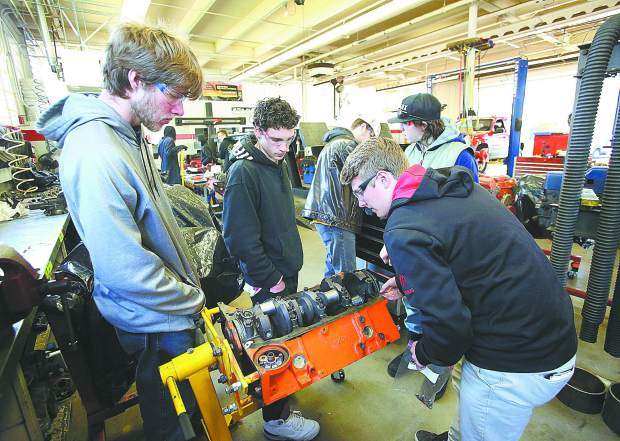 Nevada Union High School students work on a 302 engine during the regular school year. Career technical education officials are advocating for more journeyman types of education to help fulfill a jobs void.