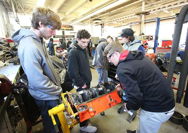 Nevada Union High School students work on a 302 engine during the regular school year. Career technical education officials are advocating for more journeyman types to help fulfill a jobs void, and to improve education.