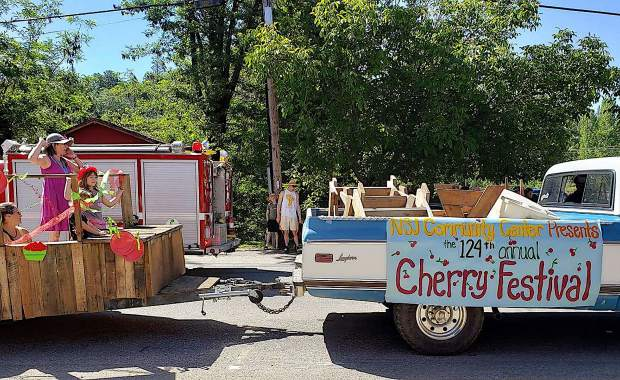 Floats make their way through downtown North San Juan Saturday to kick off the 124th annual North San Juan Cherry Festival.