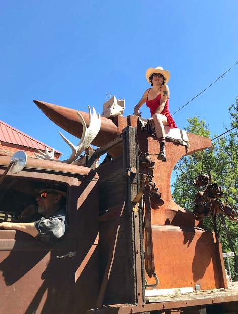 Eric Clausen's 1935 Diamond T truck makes quite a statement at the 124th annual North San Juan Cherry Festival Saturday. The parade entry featured Olive Rose riding atop a giant anvil made by Clausen, a blacksmith and knifemaker, as well as some moose horns mounted over the cab.