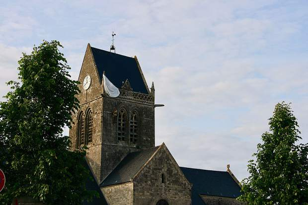 The church in Sainte Mère Eglis, with paratrooper doll hanging on the churc. On June 6, 1944,  about 14,000 allied paratroopers of the U.S. 82nd Airborne Division landed here in the course of Operation Overlord.