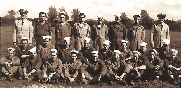 Photo of Lieutenant Donald Johnson, back left, with his Seabee unit, Normandy, France 1944.