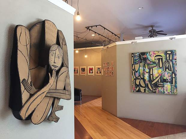 Larger than Life, a cardboard figurative sculpture, is one of several pieces by Richard Downs featured this month at the Artists' Studio in the Foothills.