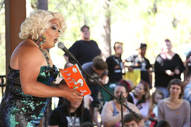 Drag queen Miss Taryn reads Green Eggs and Ham to the crowd of youngsters and their parents gathered at the Madelyn Helling Library for their story time Saturday morning. Miss Taryn traveled from Sacramento to participate in the event and received an overwhelming amount of support from community members while a small contingent of protesters held signs out front.