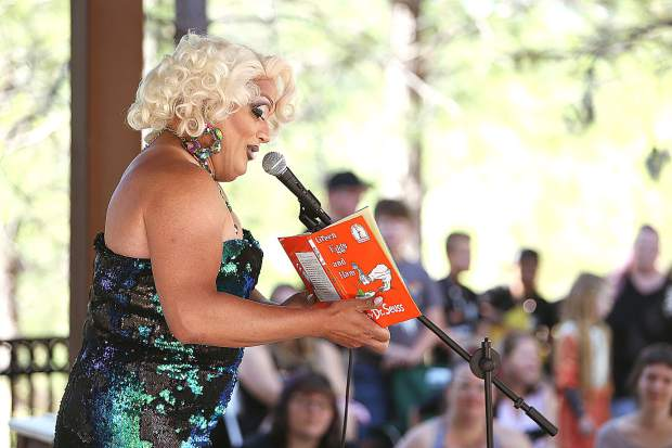 Drag queen Miss Taryn reads Green Eggs and Ham to the crowd of youngsters and their parents gathered at the Madelyn Helling Library for their story time Saturday morning. Miss Taryn traveled from Sacramento to participate in the event.