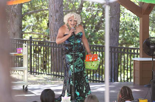 Sacramento drag queen Miss Taryn addresses the crowd of children and adults at the beginning of the story time Saturday morning at Madelyn Helling Library in Nevada City.