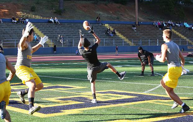 A Bear River receiver comes up with the ball in the end zone for a score against the Nevada Union Miners during Wednesday's 7 on 7 scrimmage.