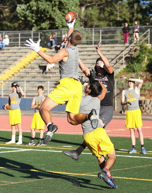 Nevada Union's Jaxon Horne goes up to block a pass intended for Bear River's Tre Maronic.