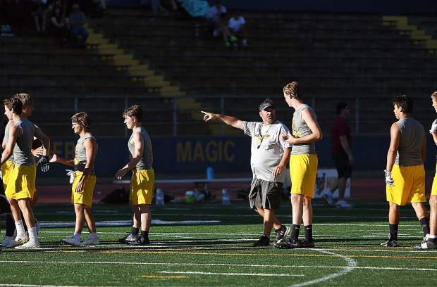 Nevada Union Miners varsity head coach Brad Sparks directs his team during the 7 on 7 scrimmage against the Bear River Bruins Wednesday at Hooper Stadium.