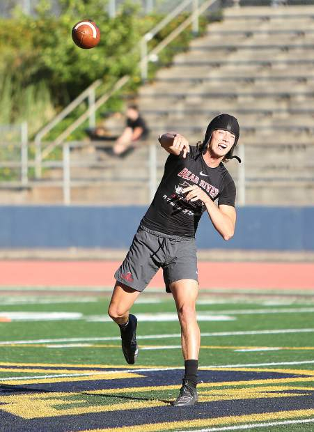 Bear River senior quarterback Tre Maronic pulls back for a pass during a 7 on 7 scrimmage against Nevada Union High School Wednesday afternoon at Hooper Stadium.