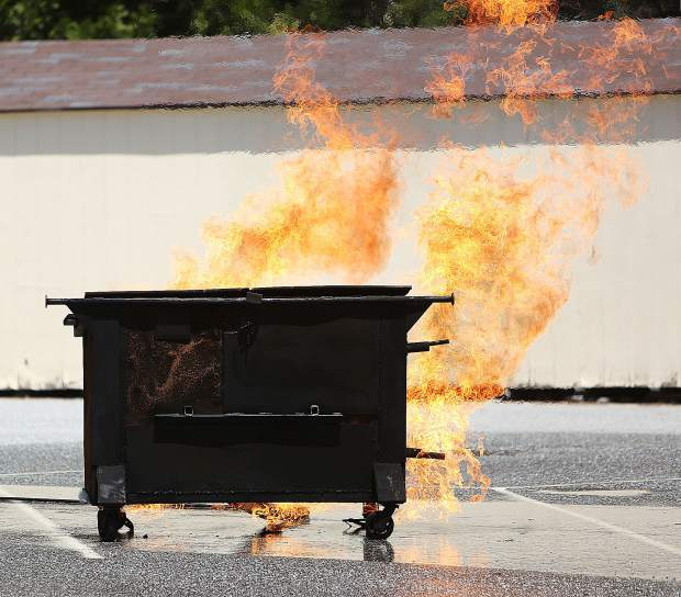 Propane gas is pumped into the dumpster and bursts into flames for the firefighters to extinguish during last week's Tahoe National Forest fire training.