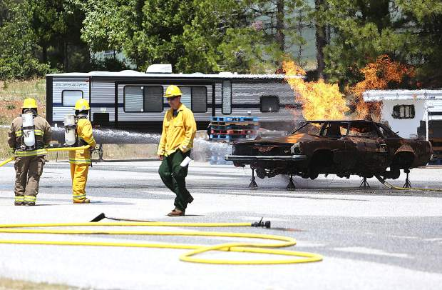 About 60 firefighters from the Tahoe National Forest took part in an annual all-hazard response training late last week at the Grass Valley Interagency Air Attack Base off of Loma Rica Drive. The firefighters, some of them who have just started their careers, learned best practices for extinguishing vehicle and Dumpster fires to help prevent their potential spread to a wildfire.