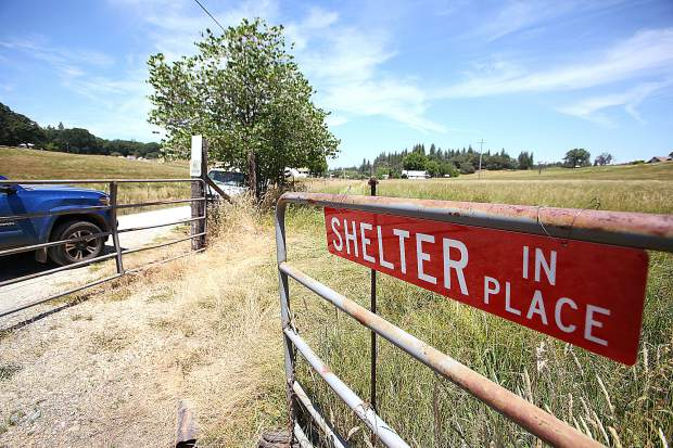 Red shelter in place signs can be seen in areas of the Bitney Springs firewise community, including along Personeni Lane where rancher Jim Gates has allowed for folks to use his pasture to escape a wildfire.