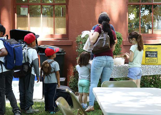 Folks get in line to take advantage of the free summer lunch program Friday behind the Grass Valley Library. The food comes from the central kitchen of Grass Valley School District and utilizes funding from a federal grant.
